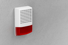 Alarm siren. With flash light attached on wall Stock Photo
