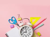 Alarm with supplies. Back to school theme stock photo