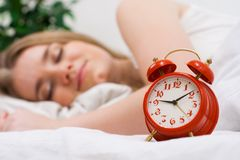 Alarm and sweet dreams Stock Image