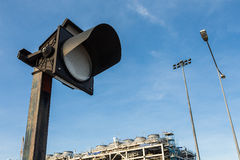 ALARM TRAFFIC-LIGHT. Alarm traffice signal light on blue sky Stock Image