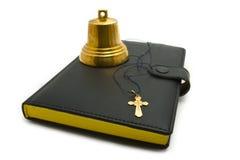 Alarma de mano, daga y la biblia Foto de archivo libre de regalías