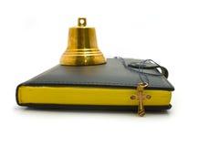 Alarma de mano, daga y la biblia Fotografía de archivo libre de regalías