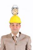 Alarma del reloj del hombre de negocios en su cabeza Fotos de archivo