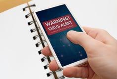 Alarma del virus en Smartphone Imágenes de archivo libres de regalías