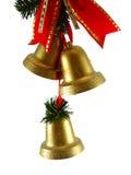 Alarmas de la Navidad y ribon rojo Imagen de archivo libre de regalías