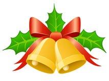 Alarmas del oro de la Navidad con el arqueamiento de la cinta y el pasto del acebo Imagen de archivo