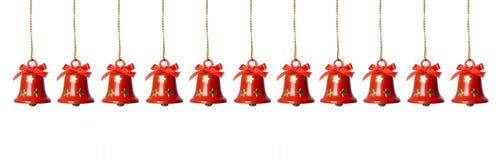 Alarmas del retintín que cuelgan en una fila Foto de archivo libre de regalías