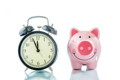 Alarmclock with piggybank on white background. Alarmclock with piggybank on white background Stock Photos