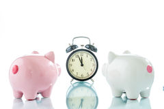 Alarmclock with piggybank on white background. Alarmclock with piggybank on white background Royalty Free Stock Photography