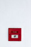 Alarme de incêndio na parede do cimento Imagens de Stock
