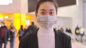 Alarmed female traveler wears medical mask China