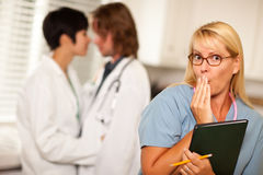 Alarmed Medical Woman Witnesses Colleagues Romance Stock Images