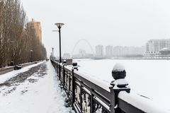 Ridiculous avenue in Astana. Alarming the alley on the embankment in bad weather in Astana Stock Image