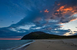 Alarming sunset on the seashore. Far East of Russia. East (Japan) Sea Royalty Free Stock Images