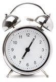 Alarmuhr auf weißem Hintergrund stockbild