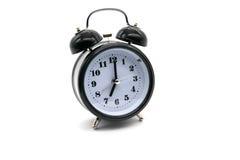 Alarmuhr auf weißem Hintergrund Lizenzfreies Stockfoto