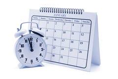 Alarmuhr und Kalender Stockbild