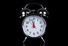Alarmuhr vor Schwarzem Lizenzfreies Stockbild