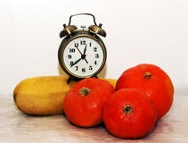 Alarrm clock and pumpkin Royalty Free Stock Images