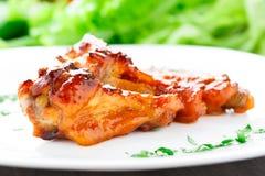 Alas de pollo con la salsa de la miel Imágenes de archivo libres de regalías
