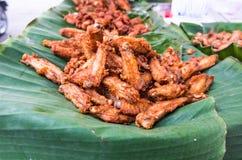 Alas de pollo encendidas Foto de archivo libre de regalías