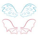 Alas de un ángel y de un diablo Foto de archivo libre de regalías