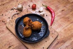 Alas del pollo en frito Fotografía de archivo