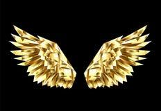 Alas poligonales del oro en fondo negro Foto de archivo libre de regalías