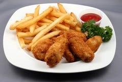 Alas y fritadas de pollo Foto de archivo libre de regalías