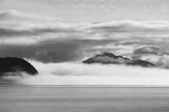 Alaska. In it's all beauty with sunken mountains inside a thick fog royalty free stock photo