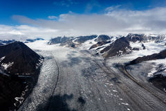 Alaska aerial landscape of mountaintops and wide glacial valleys and ice flows Stock Photos