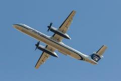 Alaska Airlines Dash 8. Taking off Runway 34R at Seattle Tacoma International Airport stock photos