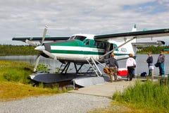 Alaska - Boarding Talon Air Float Plane. Passengers boarding a Talon Air Service De Havilland Otter Float plane on a lake near Soldotna, Alaska in preparation to Royalty Free Stock Photos