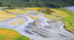 Alaska Braided Glacial River Delta In Lake Clark National Park. An aerial view flying over the coastal salt marsh and braided glacial rivers of Lake Clark Royalty Free Stock Photos