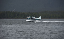 Alaska Bush Pilot Take Off Float Plane Royalty Free Stock Images