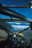 Alaska bush plane flying high over and approaching Knik Glacier, Royalty Free Stock Images
