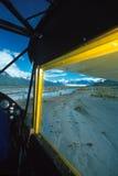 Alaska bush plane flying low and slow over gravel bar near Knik Royalty Free Stock Photos