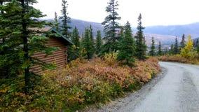 Alaska cabin at seasons`s end. Stock Photos