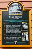 Alaska - Creek Street Star House Historic Marker Sign. This historic marker sign tells the story of the Star House, a one time dance hall and bar, now a tourist stock photography