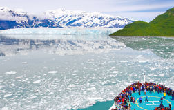 Alaska Cruise Ship Icebergs and Glaciers. Passengers fill the bow area helicopter pad of the Royal Caribbean cruise ship Radiance of the Seas in Disenchantment stock photo