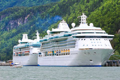 Alaska Cruise Ships Radiance and Rhapsody. The Royal Caribbean Radiance of the Seas (front) and Rhapsody of the Seas (rear) cruise ships tied up at the Railroad Stock Image