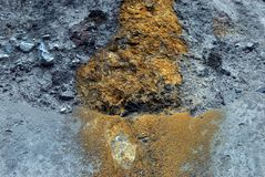 Alaska- A Deposit of Copper in a Cliff Face Along the Copper Riv. The Copper in this cliff face stands in stark contrast to the surrounding gray rock. Wrangell stock photo
