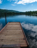 Alaska dock and lake. Reaching out over the water like a promise of adventure Royalty Free Stock Images