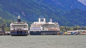 Alaska Ferry Columbia in Skagway. The Alaska Ferry Columbia (front) and Holland America Line Amsterdam cruise ship (rear) in Skagway, Alaska stock photography