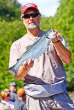 Alaska - Fishing Guide with Sockeye Salmon Stock Image