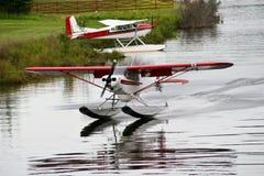 Alaska Float Plane. A photo of an Alaskan sea plane landing on the water Royalty Free Stock Photos