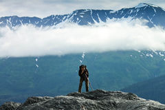 Alaska Fog and Photos on a Glacier's Edge. Photographer shoots Alaska Exit Glacier from edge along the trail Stock Photography