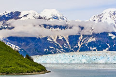 Alaska Haenke Island Hubbard Glacier. A view of Haenke Island in iceberg filled Disenchantment Bay, with Hubbard Glacier and the St. Elias Mountains in the Royalty Free Stock Images