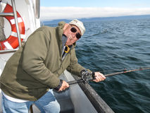 Alaska -  Happy Man Tired Halibut Fishing Stock Photography