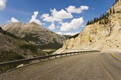 Alaska highway through Muncho Lake Provincial Park royalty free stock photos